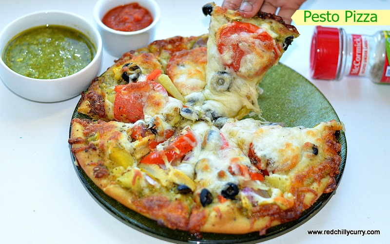 pesto pizza,pesto sauce,how to make pizza at home,how to make pesto pizza at home,pesto pizza recipe,homemade pesto pizza,pizza recipe,indian pizza recipe,pizza from scratch,how to make pizza base