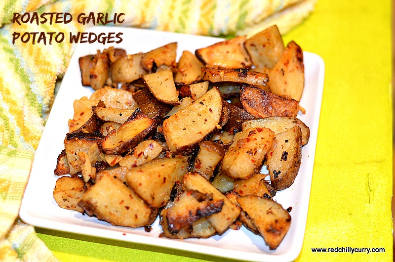 roasted garlic potato wedges, oven recipes,barbaque recipe,potato grill,oven roasted potato,potato wedges,how to make potato wedges,garlic potatoes,parmesan potatoes,party finger food,finger food recipes,potato recipes,quick finger food,italian potato roast,easy finger food,potato finger fod,recipes with potatoes,garlic roasted potatoes,potato roast